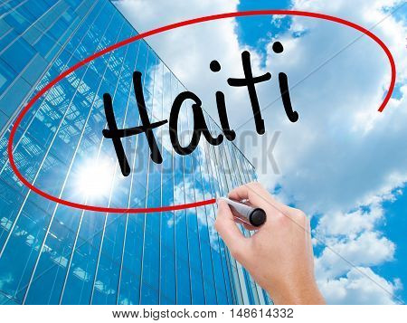Man Hand Writing Haiti With Black Marker On Visual Screen