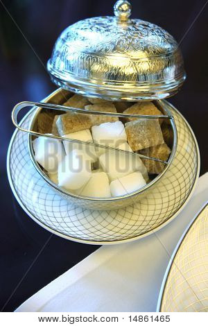 Elegant silver holder with sugar cubes for traditional English teatime