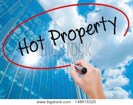 Man Hand Writing Hot Property With Black Marker On Visual Screen
