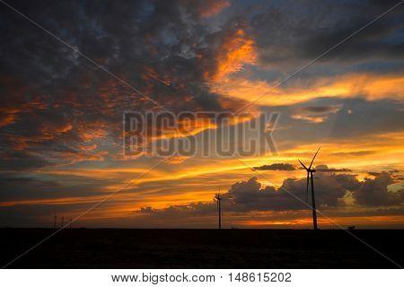 Wind turbines at sunset on a Kansas farm