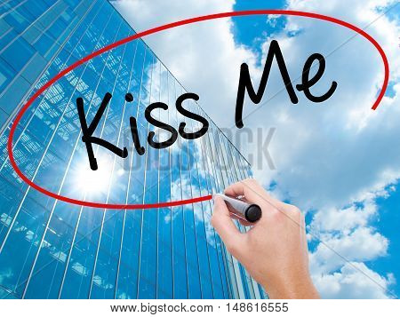 Man Hand Writing Kiss Me With Black Marker On Visual Screen