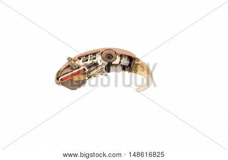 Old hearing aid cut in half isolated on white. Clipping path included.