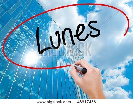 Man Hand Writing Lunes (monday In Spanish) With Black Marker On Visual Screen