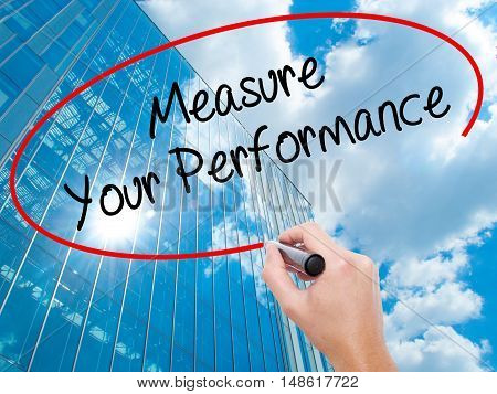 Man Hand Writing Measure Your Performance With Black Marker On Visual Screen