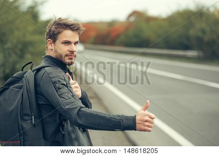Young Guy Hitchhiking Autostop