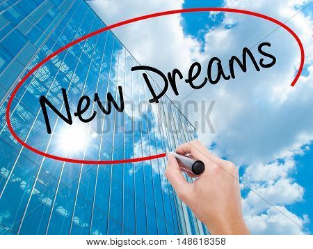 Man Hand Writing New Dreams With Black Marker On Visual Screen