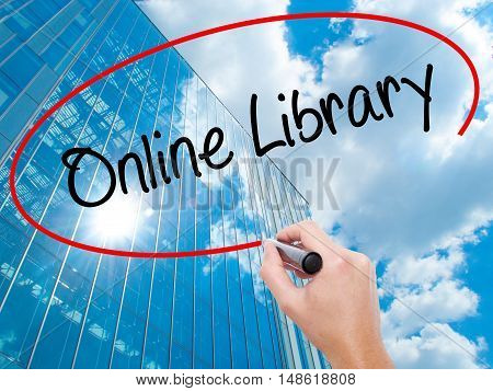 Man Hand Writing Online Library With Black Marker On Visual Screen