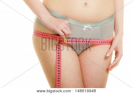 Woman In Lingerie Measuring Her Hips With Measure Tape.