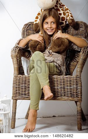 little cute brunette girl at home interior happy smiling close up, lifestyle real people concept
