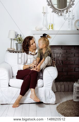 happy smiling mother with little cute daughter at home interior, casual look modern real family, lifestyle people concept close up
