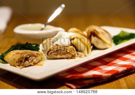 Rolls Of Russian Pancakes Stuffed With Meat  Sour Cream.