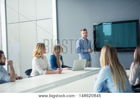 Handsome businessman making a presentation in the conference room.