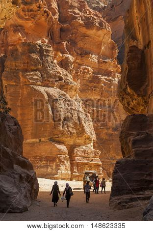 PETRA JORDAN - OCTOBER 29 2014: Unidentified locals and tourists near Al Khazneh (The Treasury).
