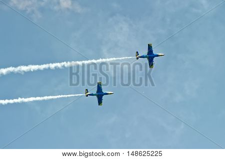 Kharkiv Ukraine - August 20 2016: Two jet L-29 Dolphin (NATO reporting name: Maya) trainer airplane flying at the airfield Korotych Kharkov region Ukraine on August 20 2016