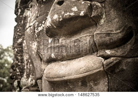 Mystery smile of Bayon in the ancient Khmer kingdom, Siem reap, Cambodia.