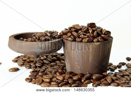 offee beans in a wooden box with copy space selective focus.