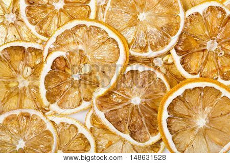Background of Sun-dried (dried) lemon close up