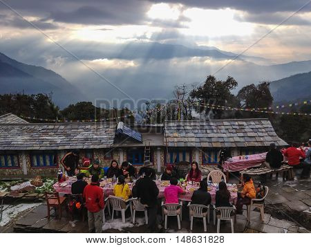 ANNAPURNA NEPAL - APRIL 8 2012 : Mountaineers eat breakfast at guest house on the way to Annapurna Base Camp Nepal