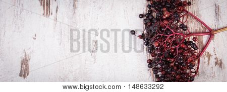Bunch of fresh elderberry on old rustic wooden background healthy food nutrition and alternative medicine copy space for text