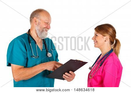 Picture of a happy doctor discussing patient's treatment with a young nurse