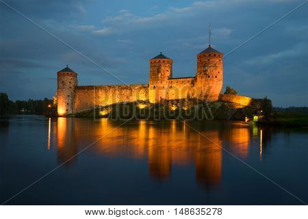 View of the towers of the Olavinlinna fortress in the august twilight. Savonlinna Finland