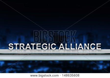 strategic alliance on metal railing with blurred background
