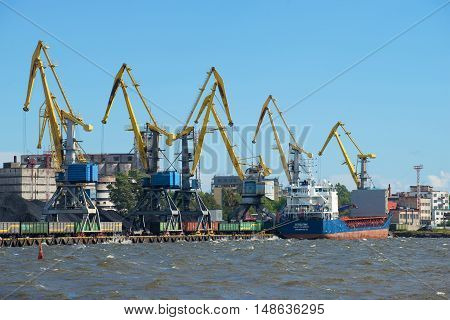 VYBORG, RUSSIA - AUGUST 08, 2016: Sunny august day at the cargo port of Vyborg. Historical landmark of the city Vyborg, Russia