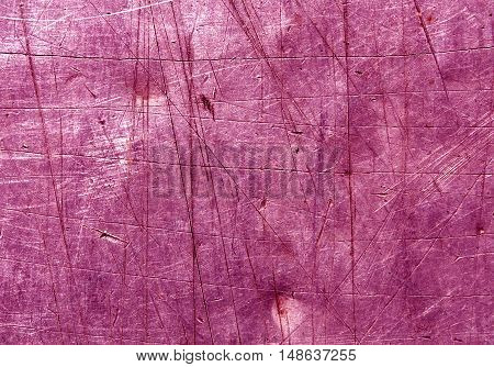 Pink Scratched Metal Surface.
