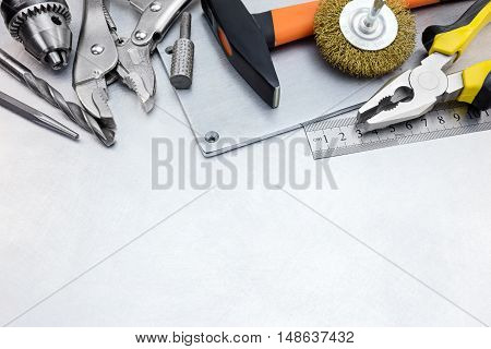 Tool Set Of Instruments For Construction And Repair On Metal Background