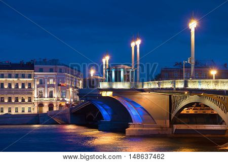 ST. PETERSBURG, RUSSIA - AUGUST 09, 2016: The central part of the Annunciation bridge in night landscape. Historical landmark of the city Saint Petersburg