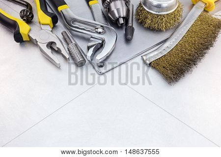 Set Of Hand Tools For House Renovation On Scratched Metal Plate