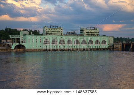 VOLKHOV, RUSSIA - JUNE 03, 2016: Volkhov hydroelectric power plant closeup in the june twilight. Historical landmark of the city Volkhov