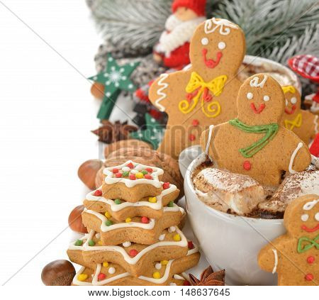 Hot chocolate and Christmas gingerbread men on a white background