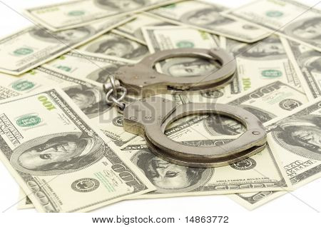 Handcuffs on money background