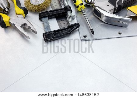 Tool Set Of Various Instruments For House Renovation And Hand Work On Metal Background