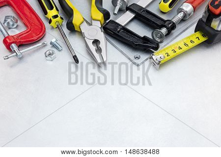 Set Of Different Tools And Instruments For House Renovation On Scratched Metal Background