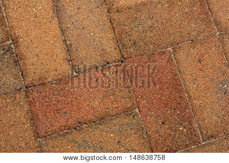 rough old orange bricks used as pavers