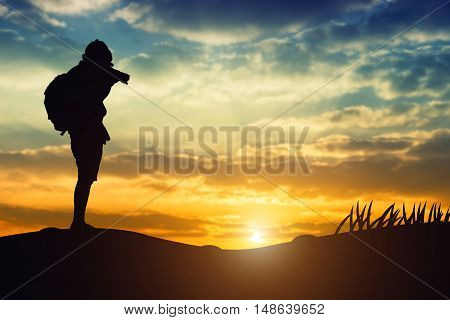 Silhouette Of A Young Who Like To Travel And Photography, Taking Pictures Of The Beautiful Moments D