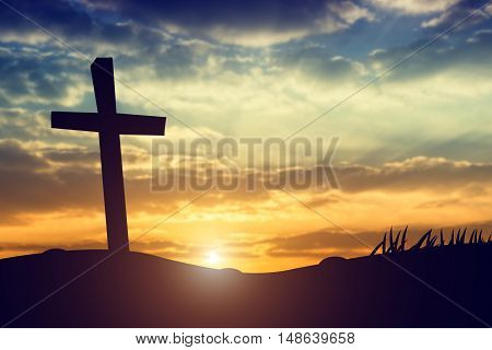 cross silhouette on the mountain at sunset
