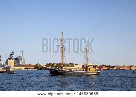 Copenhagen, Denmark - September 14, 2016: A sailboat cruising through Copenhagen harbor