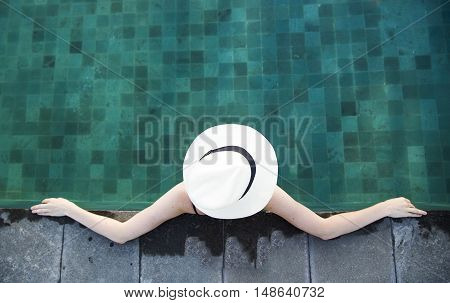 young woman in a swimming pool in Bali