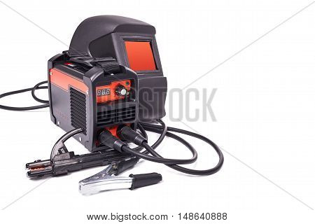 Inverter welding machine, welding equipment, isolated on a white background, welding mask, high-voltage wires with clips, set of accessories for arc welding