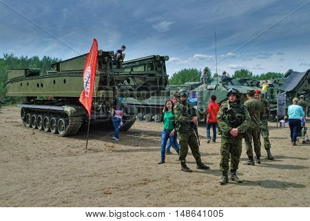Tyumen, Russia - June 11, 2016: Cadet of Tyumen highest military and engineering command school in Polite people uniform and visitors of show near Bridge layer MTU-72