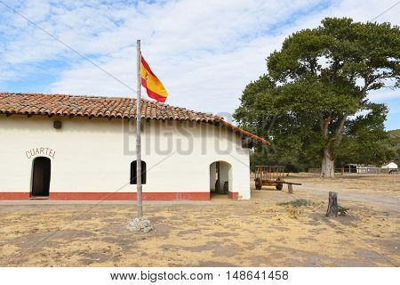 LOMPOC, CALIFORNIA - SEPTEMBER 21, 2016: Spanish Flag and Cuartel (barracks) at La Purisima Mission. La Purisima was the 11th mission of the 21 Missions and most restored.