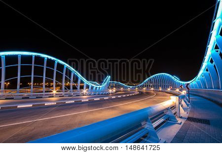 Dubai UAE 23rd September 2016: Meydan bridge outside Meydan race track illuminated at night