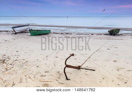 Sandy beach and facilities of collective fishing company, Gulf of Riga, Baltic Sea, Latvia