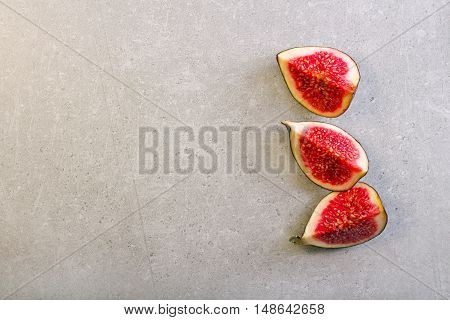 Fresh fig sliced over grange grey background top view