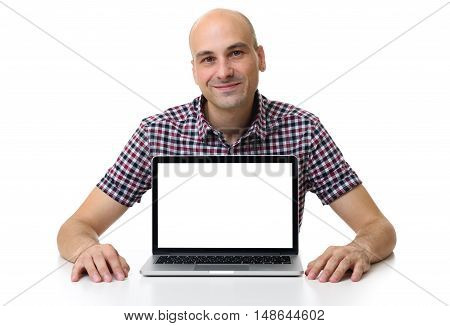 Mid Age Bald Man Sitting At Desk With Laptop