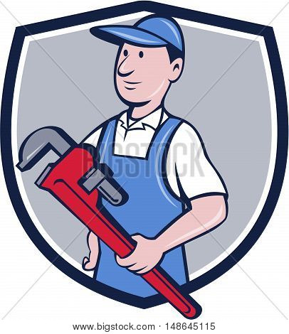 Illustration of a handyman wearing hat looking to the side holding pipe wrench viewed from front set inside crest shield on isolated background done in cartoon style.
