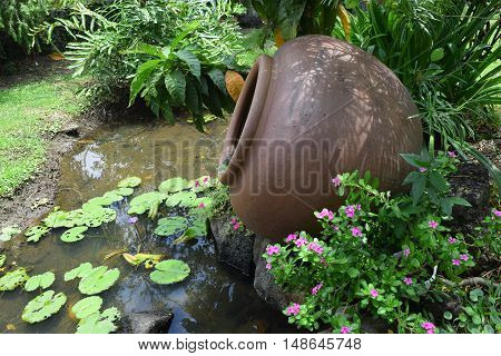 Landscaping Garden With Pottery Jar